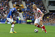 Marko Arnautovic of Stoke City (r) looks to take on Mason Holgate of Everton. Premier league match, Everton v Stoke city at Goodison Park in Liverpool, Merseyside on Saturday 27th August 2016.<br /> pic by Chris Stading, Andrew Orchard sports photography.