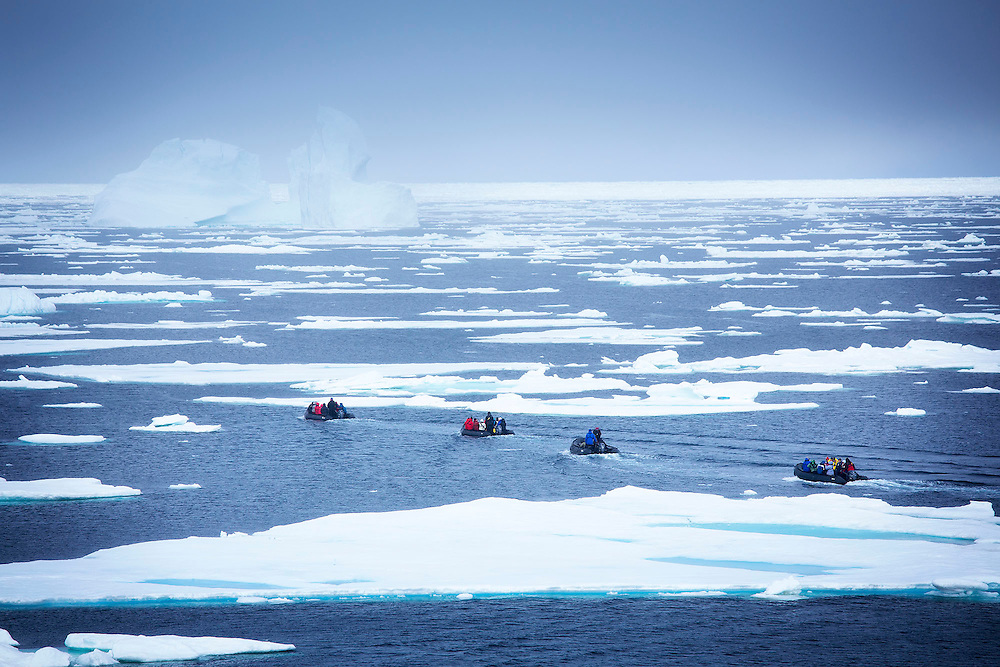 FOR MAIN ARCTIC GALLERY-TRAVEL SECTION<br /> Tourists ride in a zodiac through the pack ice at Baffin Island, Nunavut, July 23, 2015. Photograph by Todd Korol for The Toronto Star