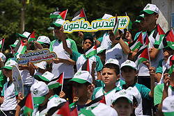 July 8, 2017 - Gaza City, Gaza Strip, Palestinian Territory - Palestinian children hold the national flags during the announcement the start of summer camps organized by the Hamas movement in Gaza city on July 8, 2017  (Credit Image: © Ashraf Amra/APA Images via ZUMA Wire)