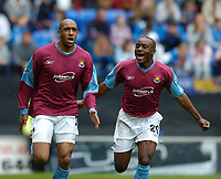 Photo. Jed Wee.<br /> Wigan Athletic v West Ham United, Nationwide League Division One, 09/05/2004.<br /> West Ham's Brian Deane (L) scores to send West Ham into the playoffs and dump Wigan out, as Nigel Reo-Coker joins in the celebrations.