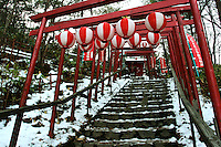 Torii in Snow - A torii is a traditional Japanese gate commonly found at the entry to a Shinto shrine.  The basic structure of a torii is two columns that are topped with a horizontal rail. Slightly below the top rail is a second horizontal rail. Torii are traditionally made from wood and are usually painted vermilion red.