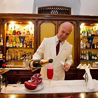 VENICE, ITALY - DECEMBER 02:  The head barman of the Caffe Florian prepares a Pomgranate Cocktail on December 2, 2011 in Venice, Italy.The Venetian coffee houses have a  long standing history, established at the beginning of 1700 around St. Mark Square have been the centre of cultural meeting and innovations for centuries and served customers like Dickens, Goethe, Casanova and Lord Byron.