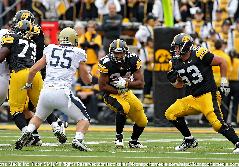 September 17, 2011: Iowa Hawkeyes running back Marcus Coker (34) looks for a hole during the first half of the game between the Iowa Hawkeyes and the Pittsburgh Panthers at Kinnick Stadium in Iowa City, Iowa on Saturday, September 17, 2011. Iowa defeated Pittsburgh 31-27.