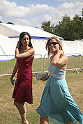 Rekha Sharma and Stephanie Newton, Cartier International Polo. Guards Polo Club. Windsor Great Park. 30 July 2006. ONE TIME USE ONLY - DO NOT ARCHIVE  © Copyright Photograph by Dafydd Jones 66 Stockwell Park Rd. London SW9 0DA Tel 020 7733 0108 www.dafjones.com