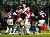 Photo. Chris Ratcliffe<br /> West Ham United v Crewe Alexandra. Coca Cola Championship. 15/03/2005<br /> Teddy Sheringham is mobbed by fellow West Ham players after his strike