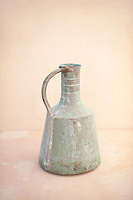 An old bronze pitcher symbol of life and sharing.