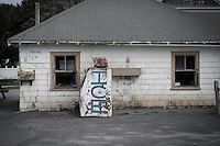 Ice machine outside of an abandoned gas station.