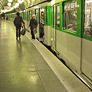 Train stopped at Paris metro station.