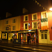 A street scene in Kenmare, Country Kerry with brightly coloured houses, shops, bars, restaurants and hotels  County Kerry, Ireland. Photo Tim Clayton