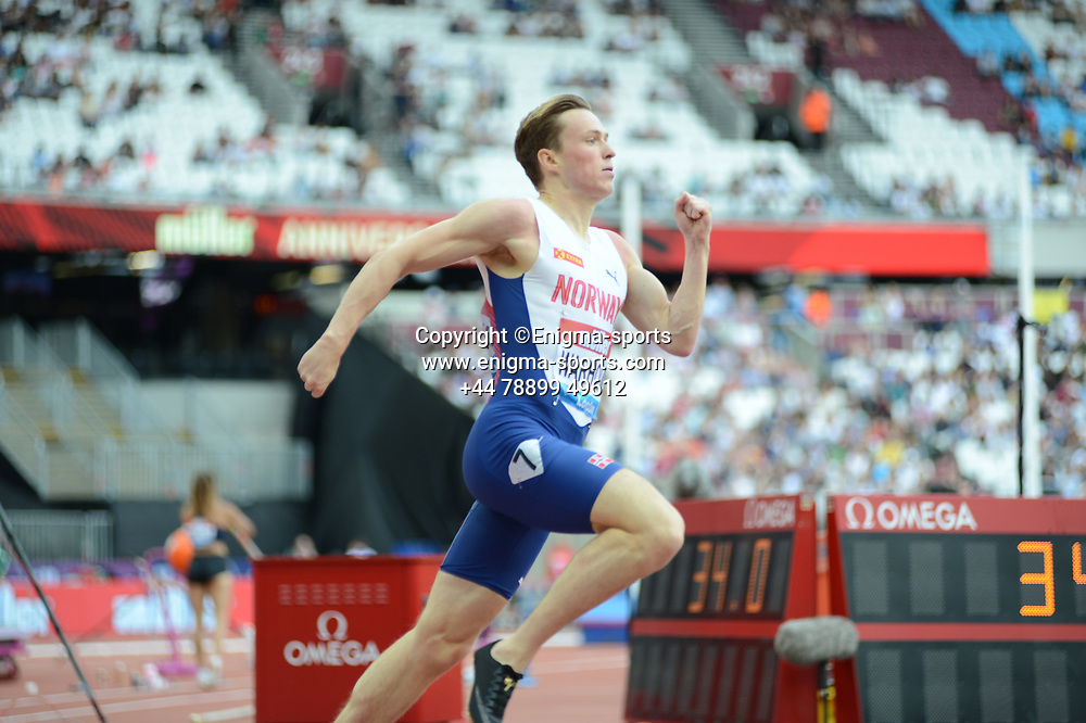 Karsten Warholm competes in the men's 400m hurdles during the IAAF Diamond League at the Queen Elizabeth Olympic Park London, England on 20 July 2019.
