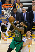 Boston Celtics forward Amir Johnson (90) lays the ball in over Golden State Warriors center Zaza Pachulia (27) at Oracle Arena in Oakland, Calif., on March 8, 2017. (Stan Olszewski/Special to S.F. Examiner)