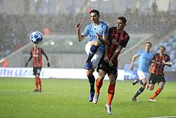 Manchester City U19's Nabil Touaizi battles for the ball with Shakhtar Donetsk's Andriy Kulakov