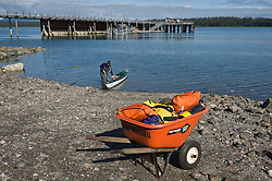 Glacier Bay National Park and Preserve provides wheel barrows at the Bartlett Cove Visitor Information Station for visitors to use to transport camping equipment from the Bartlett Cove dock to the Bartlett Cove campground. In the background is the Bartlett Cove fuel dock. Glacier Bay National Park and Preserve is located in southeast Alaska.