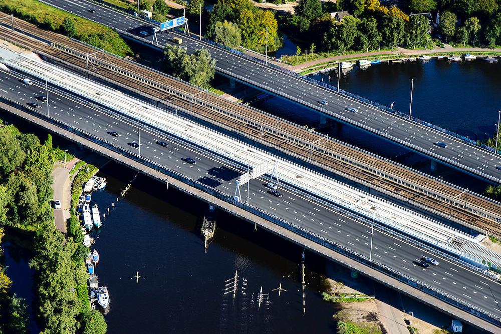 Nederland, Noord-Holland, Amsterdam, 27-09-2015; roeiers op de Amstel te hoogte van de Rozenoordbrug, een complex van drie bruggen voor spoor, metro en autoverkeer (Ring A10). <br /> Rowers on the river Amstel near the Rozenoord Bridge, a complex of three bridges for rail, metro and traffic.<br /> <br /> luchtfoto (toeslag op standard tarieven);<br /> aerial photo (additional fee required);<br /> copyright foto/photo Siebe Swart
