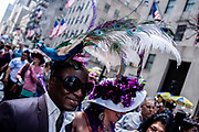 New York, NY - April 16, 2017. A man wears a headpiece in the form a a bright peacock at New York's annual Easter Bonnet Parade and Festival on Fifth Avenue.