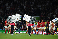 the ground staff are quick to remove the post pads as Wales players celebrate their win. Rugby World Cup 2015 pool A match, England v Wales at Twickenham Stadium in London, England  on Saturday 26th September 2015.<br /> pic by  Andrew Orchard, Andrew Orchard sports photography.