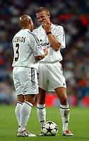 Fotball<br /> Kvalifisering til UEFA Champions League<br /> 25.08.2004<br /> Foto: SBI/Digitalsport<br /> NORWAY ONLY<br /> <br /> Real Madrid v Wisla Krakow<br /> <br /> Real Madrid's David Beckham and Roberto Carlos discuss who should take a free kick