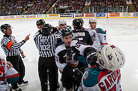 KELOWNA, CANADA - FEBRUARY 10: Referee Kevin Bennett calls penalties as linesman Dustin Minty attempts to break apart players of the Vancouver Giants and Kelowna Rockets on February 10, 2017 at Prospera Place in Kelowna, British Columbia, Canada.  (Photo by Marissa Baecker/Shoot the Breeze)  *** Local Caption ***