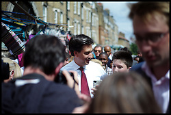 Ed Miliband during an East Street Market visit after being egged by a member of public during a  living standards related visit to South East London's East Street Market.  This is Milliband's first official visit since coming back from holiday, <br /> East Street Market, London, United Kingdom. Wednesday, 14th August 2013. Picture by Andrew Parsons / i-Images
