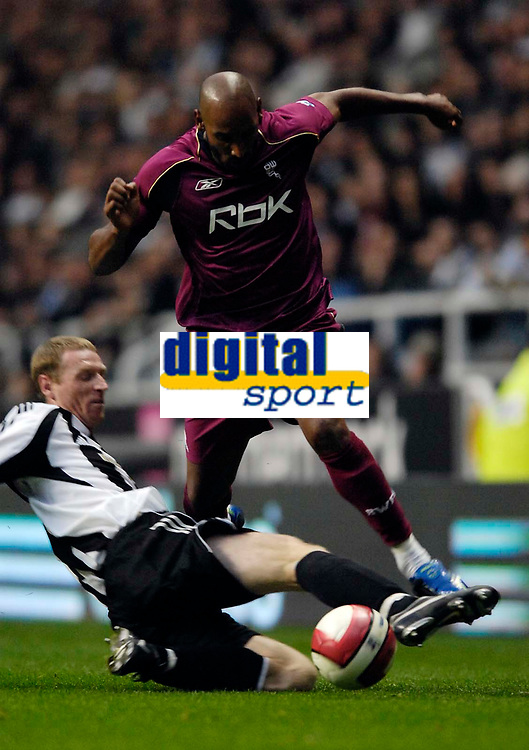Photo: Jed Wee.<br /> Newcastle United v Bolton Wanderers. The Barclays Premiership. 15/10/2006.<br /> <br /> Bolton's Nicolas Anelka (R) hurdles over a challenge from Newcastle's Craig Moore.
