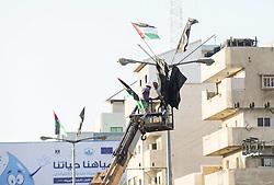 October 19, 2016 - Gaza City, The Gaza Strip, Palestine - Two Palestinians pin Islamic Jihad flags during a military parade marking the Islamic Jihad 29th foundation anniversary in Gaza city. (Credit Image: © Mahmoud Issa/Quds Net News via ZUMA Wire)