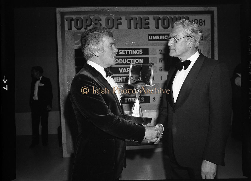 """Tops of the Town Final.   (N79)..1981..31.05.1981..05.31.1981..31st May 1981..The John Player sponsored Tops Of The Town competition had its final tonight in the Gaiety Theatre, Dublin.The overall winners were the Limerick Insurances Group..Image shows Mr Harry Nolan (L), Group leader of the Irish Biscuits show, (Semi Finalist in """"Tops"""") and Mr Oliver Casey , Managing Director, John Player..Photo shows the producers of the finalists in the """"Tops"""" competition, Mr Douglas Howell, Limerick Insurances Group and Mr Raymond Kirk, St Joseph's Youth Club, Strabane."""