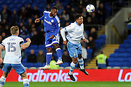 Cardiff City's Junior Hoilett (c) heads at goal challenged by Sheffield Wednesdays Liam Palmer (r). EFL Skybet championship match, Cardiff city v Sheffield Wednesday at the Cardiff city stadium in Cardiff, South Wales on Wednesday 19th October 2016.<br /> pic by Carl Robertson, Andrew Orchard sports photography.
