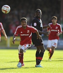 Swindon Town's Nathan Byrne chases the loose ball - Photo mandatory by-line: Joe Meredith/JMP - Tel: Mobile: 07966 386802 04/05/2013 - SPORT - FOOTBALL - County Ground - Swindon - Swindon Town v Brentford - Npower League one Play Off