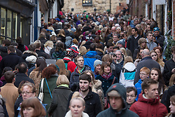 © Licensed to London News Pictures. 3/12/2016. Lincoln, UK. Thousands of people descended upon Lincoln over the weekend to start their Christmas shopping and visit the annual Christmas market. With over 200 stalls surrounding the Cathedral and Castle in the uphill area a one way system to control visitors had to be put in place due to the huge crowds thronging the City Centre. Picture shows packed crowds on Steep Hill around the Uphill area of the City. Photo credit: Dave Warren/LNP