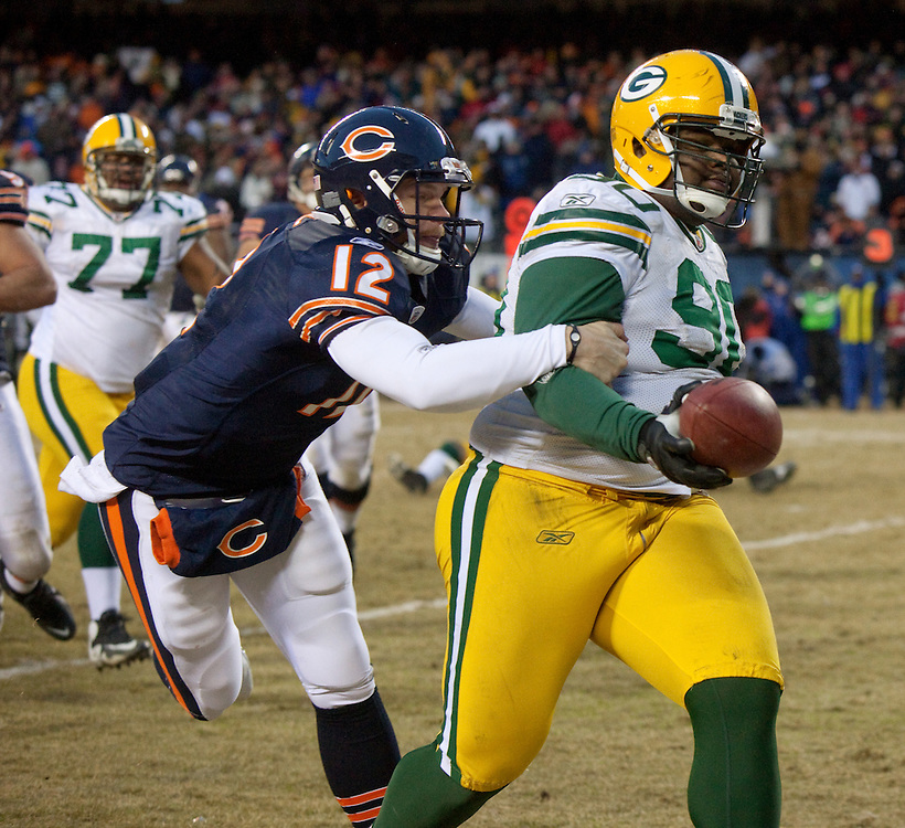 NFC Championsihp.Green Bay Packers defensive tackle B.J. Raji (90) makes a touchdown as Chicago Bears quarterback Caleb Hanie (12) tries to stop him in the second half..