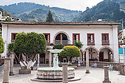 The old city hall building on the Plaza de la Constitucion in Angangueo, Michoacan, Mexico. Angangueo is a tiny, remote mountain town and the entry point to the Sierra Chincua Monarch Butterfly Sanctuary.