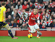 Arsenal's Jack Wilshere running towards Sunderland's Phil Bardsley during Barclays Premier League , Arsenal v Sunderland at the Emirates Stadium in London, England on Saturday 22nd Feb 2014.<br /> pic by John Fletcher, Andrew Orchard sports photography.