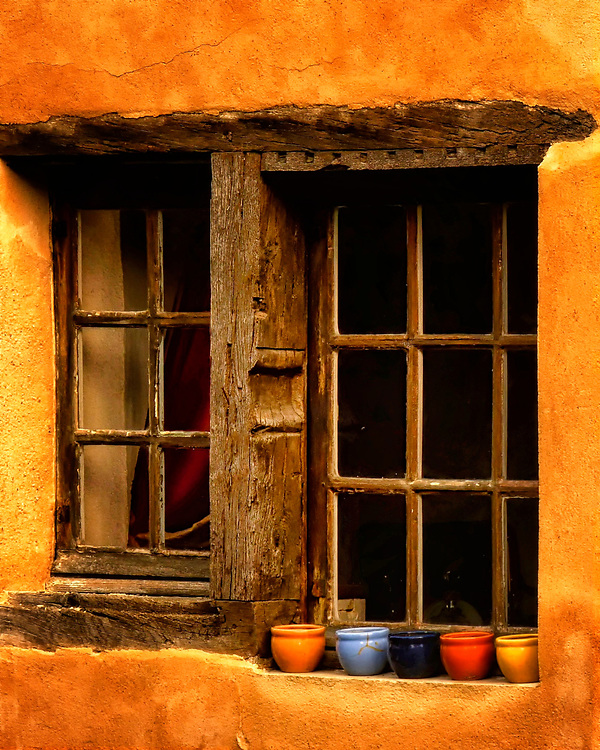 Architectural scene of window in the village of Montfort, in the Dordogne region of France.