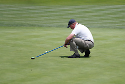 June 11, 2019 - Pebble Beach, CA, U.S. - PEBBLE BEACH, CA - JUNE 11: A USGA official uses a stimp meter on the 18th green during a practice round for the 2019 US Open on June 11, 2019, at Pebble Beach Golf Links in Pebble Beach, CA. (Photo by Brian Spurlock/Icon Sportswire) (Credit Image: © Brian Spurlock/Icon SMI via ZUMA Press)