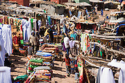 The fabric market in Mopti's harbour. At the confluence of the Niger and the Bani rivers, between Timbuktu and Segou, Mopti is the second largest city in Mali, and the hub for commerce and tourism in this west-african landlocked country.