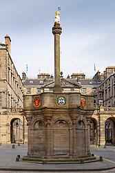 The Mercat Cross monument on Royal Mile in Edinburgh Old Town, Scotland, UK