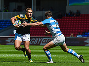 South Africa centre Franco Naude hands-off Argentina centre Juan Cruz Mallia during the World Rugby U20 Championship 3rd Place play-off  match Argentina U20 -V- South Africa U20 at The AJ Bell Stadium, Salford, Greater Manchester, England on Saturday, June 25, 2016.(Steve Flynn/Image of Sport)