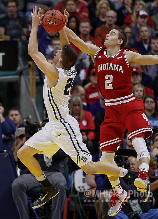 INDIANAPOLIS, IN - DECEMBER  20: Kellen Dunham #24 of the Butler Bulldogs shoots the ball as Nick Zeisloft #2 of the Indiana Hoosiers defends at Bankers Life Fieldhouse on December 20, 2014 in Indianapolis, Indiana. (Photo by Michael Hickey/Getty Images) *** Local Caption *** Kellen Dunham; Nick Zeisloft