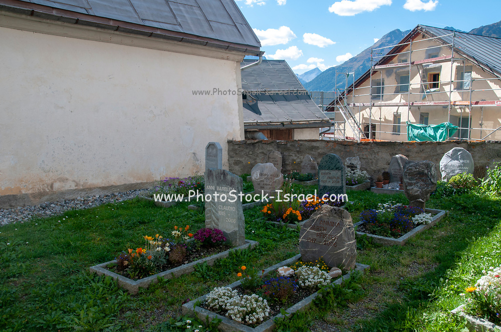 Churchyard and cemetery in the Engadine Valley village of Guarda, Switzerland