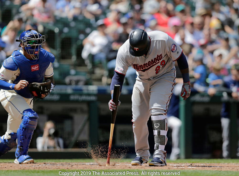 Minnesota Twins' Miguel Sano reacts after striking out to Seattle Mariners' Yusei Kikuchi during a baseball game, Sunday, May 19, 2019, in Seattle. (AP Photo/John Froschauer)