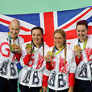 Track Cycling - Olympics: Day 8  The Great Britain team, from right, of Katie Archibald #45, Laura Trott #46, Elinor Barker #189 and Joanna Rowsell-Shand #193 celebrate after winning the gold medal in the Women's Team Pursuit Final during the track cycling competition at the Rio Olympic Velodrome August 12, 2016 in Rio de Janeiro, Brazil. (Photo by Tim Clayton/Corbis via Getty Images)
