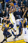 Golden State Warriors forward Kevin Durant (35) takes the ball to the basket against the Utah Jazz at Oracle Arena in Oakland, Calif., on December 27, 2017. (Stan Olszewski/Special to S.F. Examiner)