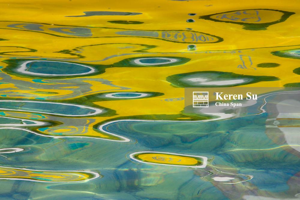 Oil pattern on water, Geneva, Switzerland