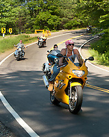 Motorcyclists enjoy a smooth ride over the newly paved Watson Road Wednesday afternoon.  (Karen Bobotas/for the Laconia Daily Sun)