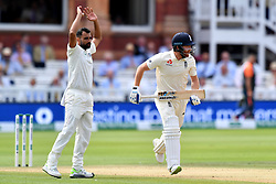 India's Mohammed Shami reacts as England's Jonny Bairstow runs between the wickets during day three of the Specsavers Second Test match at Lord's, London.