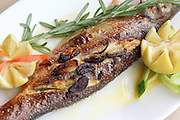 a meal of Grilled fish with lemon