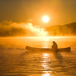 Canoeing at sunrise, Moosehead Lake, Maine.