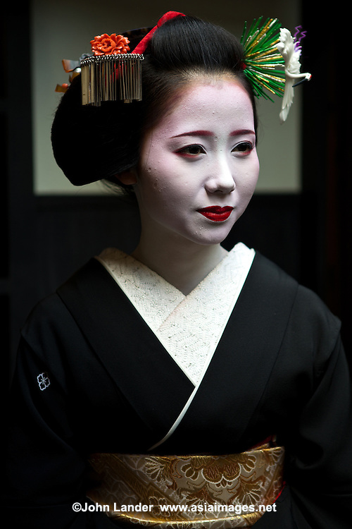 """Apprentice geisha are called maiko literally """"dance child"""". It is the maiko, with her white make-up and elaborate kimono and hairstyle, that has become the stereotype of a geisha to Westerners. Geiko as they are called in Kyoto (Geisha elsewhere in Japan) are traditional, female Japanese entertainers whose skills include performing various Japanese arts such as classical music and dance."""