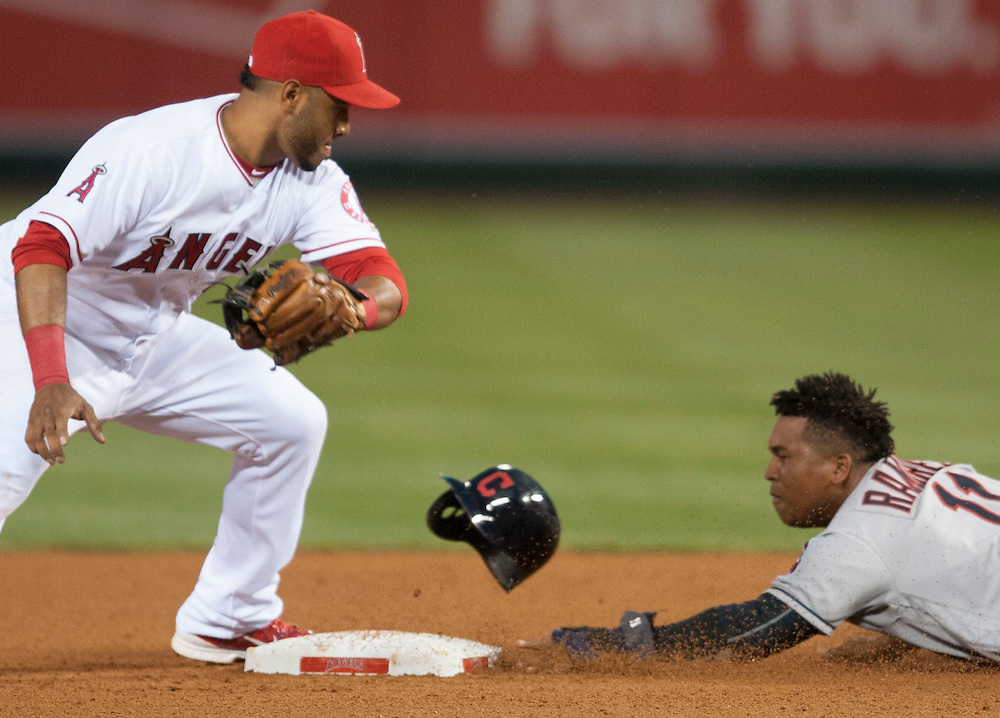 The Angels' Gregorio Petit is late with the tag as the Indians' Jose Ramirez steals second in the fourth inning Saturday at Angel Stadium.<br /> <br /> ///ADDITIONAL INFO:   <br /> <br /> angels.0612.kjs  ---  Photo by KEVIN SULLIVAN / Orange County Register  -- 6/11/16<br /> <br /> The Los Angeles Angels take on the Cleveland Indians Saturday at Angel Stadium.