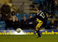 Photo: Richard Lane.<br /> Wimbledon v Stoke City. FA Cup 5th Round. 03/01/2004.<br /> Adam Nowland fires in Wimbledon's equaliser.